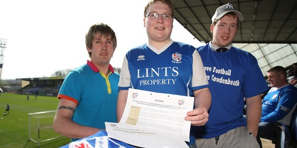 Kris Miller, Courier, 09/04/11. Picture today at Starks Park, Kirkcaldy. Pic shows travelling Cowdenbeath fans who brought a petition to back club's move to a new stadium for people to sign. L/R, Scott Gilfillan, Grant Cameron and Jamie Finlayson with the petition.