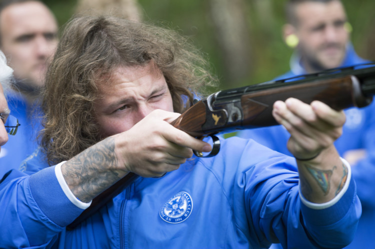 St Johnstone players enjoy a bit of rest and realxation at the Dunkeld Hilton before this weekend's William Hill Scottish Cup Final....12.05.14 Stevie May lines up a shot during clay pigeon shooting Picture by Graeme Hart. Copyright Perthshire Picture Agency Tel: 01738 623350  Mobile: 07990 594431