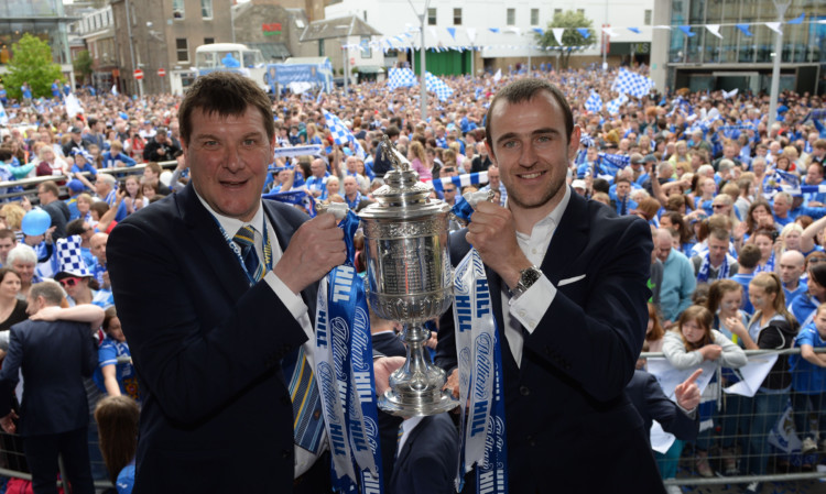 St Johnstone manager Tommy Wright (left) and captain Dave Mackay show off the Scottish Cup to the Perth public.