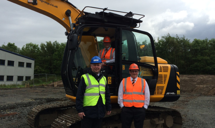 Ewan Cameron with Neil Alexander (in digger) and Stephen Ripley of Eclipse IP.