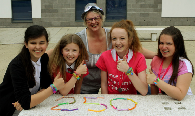 Shona Duncan of Broughty Ferry Cancer Research shop with, from left, Sophie Prendiville, Katie McGill, Laura McGill and Holly Ross.