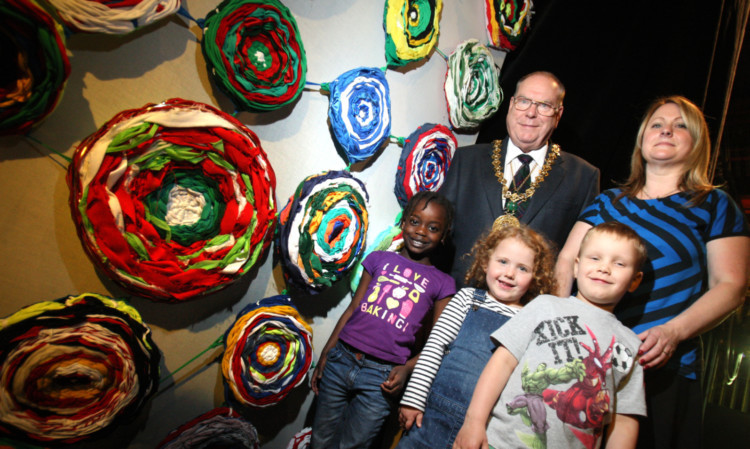 Lord Provost Bob Duncan and Cheryl McDiarmid with some of the children who helped in the creation of the woven artwork.