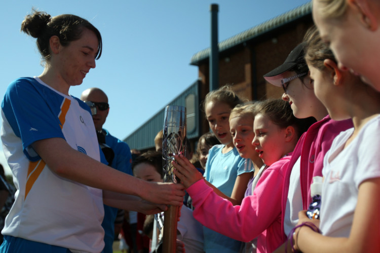 Huge crowds turned out to see the Queen's Baton Relay in Fife on June 26 as it tours the country ahead of the start of the Commonwealth Games. Here are a selection of Kris Miller's photos from earlier in the day. This one shows carrier Lucy Ellis (from Dalgety Bay) letting school children get their hands on the baton.