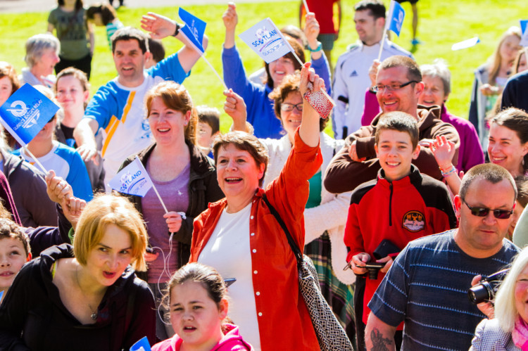 The Queens Baton Relay captured the imagination of thousands at the weekend, with communities across Perthshire and Central Scotland turning out in force to celebrate its arrival. The batons journey began on Saturday with a visit to McDiarmid Park, where it was paraded alongside the Scottish Cup. Other stops included Auchterarder, Gleneagles, Methven, Crieff, Muthill and Dunblane. On Sunday the baton went to the Stirling area. Photo shows some of the crowd at MacRosty Park in Crieff.