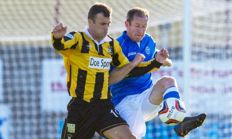 St Johnstones Frazer Wright tackles Daryl Falconer of East Fife in the friendly.