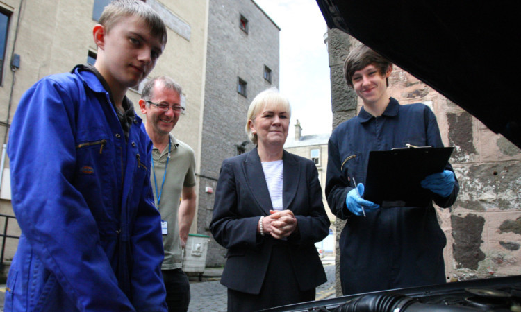 Scottish Labour leader Johann Lamont with, from left, trainee Kieran Anderson, instructor Brian Robinson and trainee Lee Clark at Helm Training in Dundee.