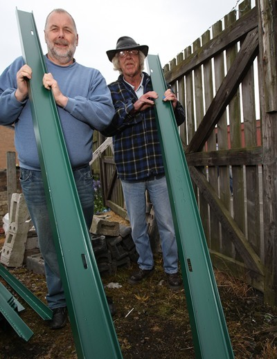Kris Miller, Courier, 15/05/11. Picture today at Clepington Allotments, The allotments are getting a new fence!!! Harry Tosh (left) and Alexander Gauld beside the old one. See Andy Argo for story.