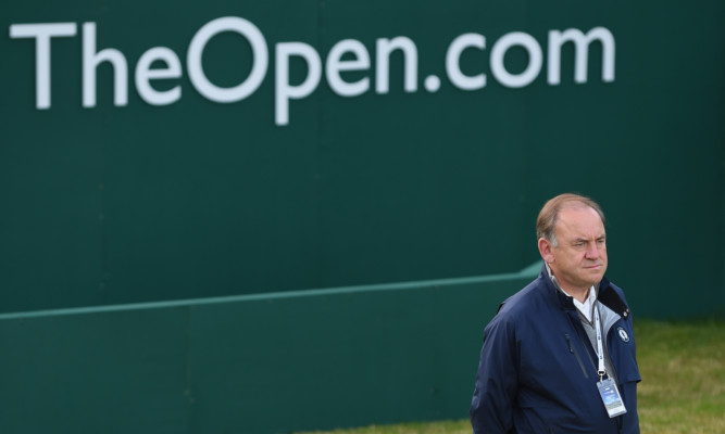 Peter Dawson looks on from the first tee as the Open gets under way on Thursday.
