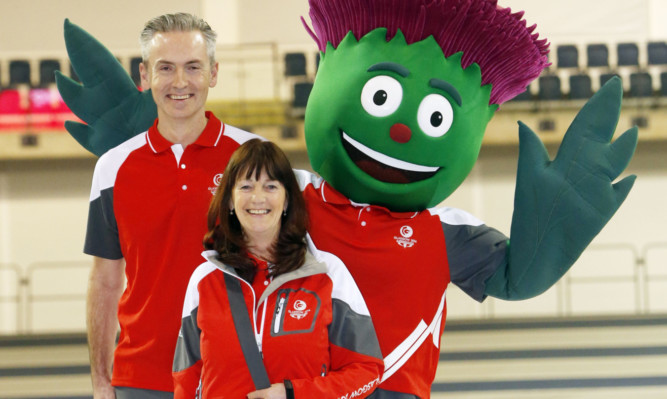 Volunteers Tony Wilson and Felicity  Bryant with Glasgow 2014 mascot Clyde.