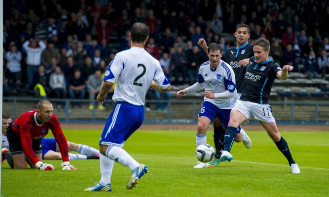 Simon Ferrry scores the opener for Dundee.
