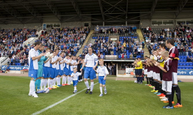 St Johnstone captain Steven Anderson exits the tunnel alongside his sons.