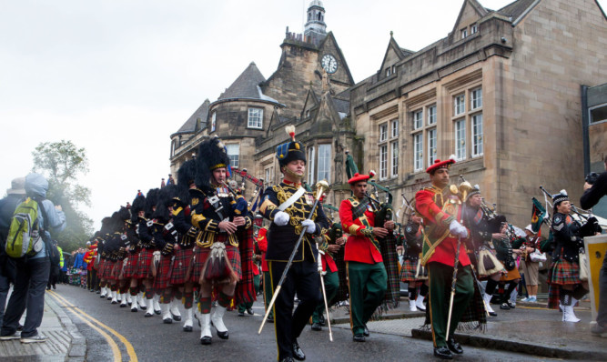 The Tattoo parade passes Stirlings municipal buildings.