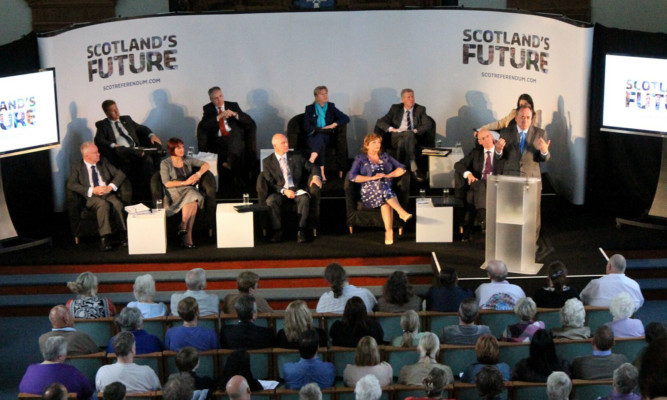 Alex Salmond takes questions from the audience at St Andrew's Church in Arbroath.