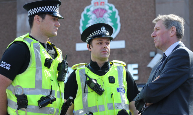 Justice Secretary Kenny MacAskill chats to PCs David Voight and Michael Anderson.