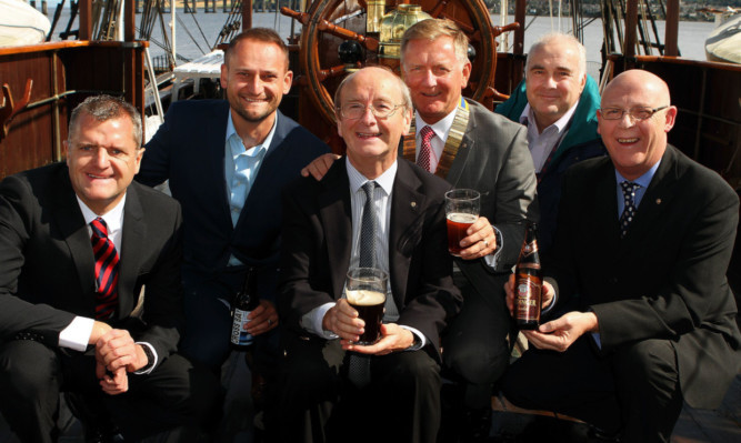 At the Oktoberfest launch at the RRS Discovery, from left: Paul Barnett, director of Barnetts Volkswagen; Craig Simpson, commercial director of Radio Tay; Jonathan Stewart of Speedwell Inns; Dundee Rotary president Robert Dunn; Mark Munsie, operations director of Dundee Heritage Trust; and Jim Pickett, director of Patch.