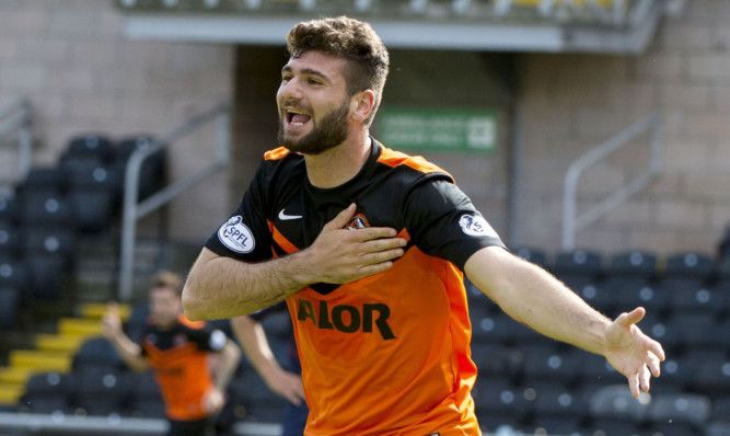 Nadir Ciftci celebrates his goal against Ross County.