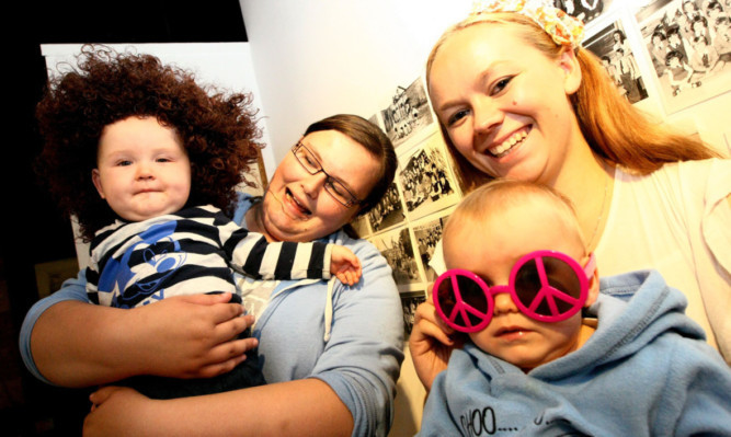Aimee Law with son William and Danielle Stephen with Reilly get in the 70s mood.