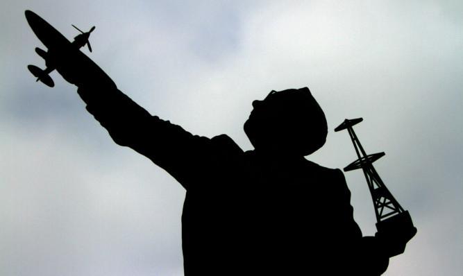 The statue features Watson-Watt holding a radar tower and Spitfire.