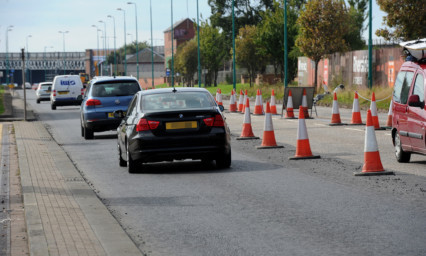 A driver has complained about the uneven new surface on Riverside Drive.