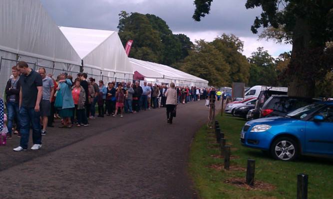 Long queues at the flower and food festival on Saturday.