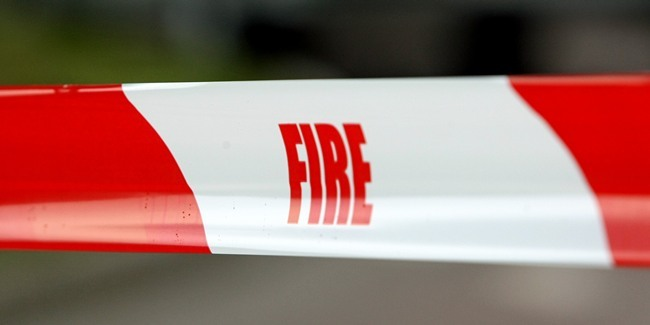 Kim Cessford, Courier 15.06.11 for file - Fire Brigade safety tape to exclude people from an incident area