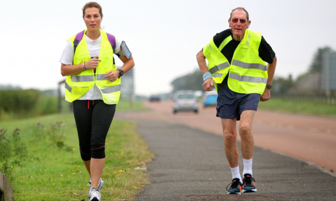 Mr Wood and Lauren jogged the 16 miles between Dundee and Arbroath.