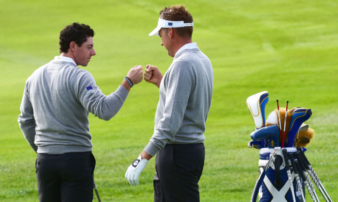 Rory McIlroy, left, and Ian Poulter in practice.