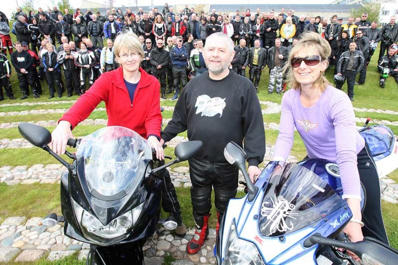 Kris Miller, Courier, 09/05/10, News. Picture today at Maggies, Dundee. Pic shows the B.A.D (Blairgowrie and District) Motorcylce Club who had their annual run to the centre to raise funds for it. Over 250 bikers registered, each paying £12 to take part and many being sponsored. The event was organised by Charlie Crichton whose wife used the centre and came up with the idea originally. Pic shows L/R, Karen Mackinnon (Info and Support Specialist, Maggies), Charlie Crichton and Lesley Howells (Centre Head) with bikers in background.