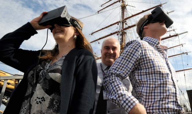 Gill Porter and Mark Munsie of Dundee Heritage Trust and Ben Bennett from Digital Surveys with one of the virtual reality headsets