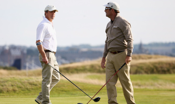 Actor Hugh Grant and musician Huey Lewis at Fairmont St Andrews on Monday ahead of the Dunhill.
