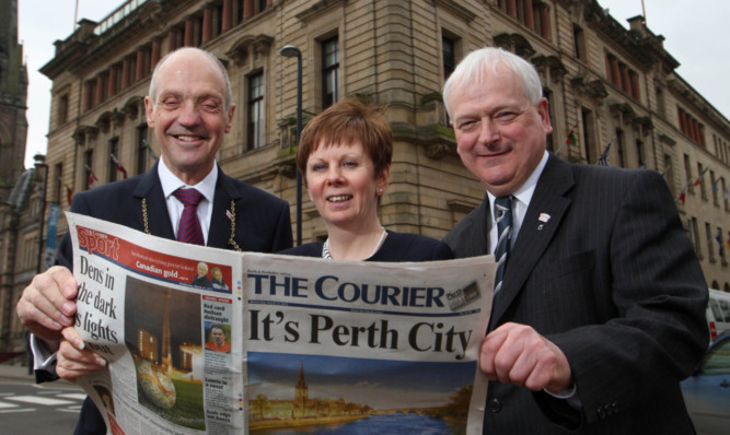 Provost Dr John Hulbert, council chief executive Bernadette Malone and leader Councillor Ian Miller celebrating confirmation of city status in March.