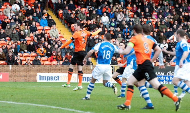 Gavin Gunning rises unmarked to open the scoring early in the first half.