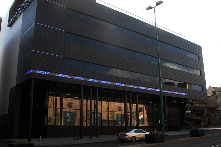 """A ticker-tape feed from the stock market on one of the city's newest buildings - the Alliance Trust corporate headquarters in West Marketgait, Dundee, features a moving readout of share prices updated on a """"live"""" basis."""