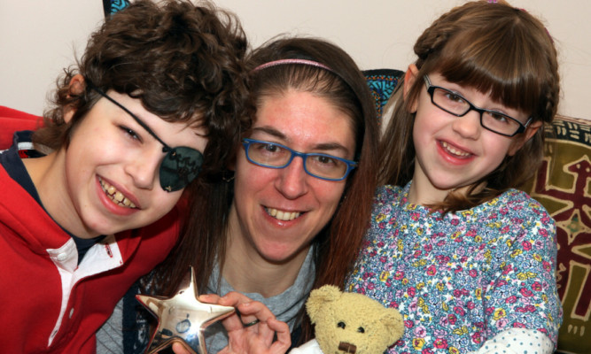 Noah with mum Brenda and sister Hannah.
