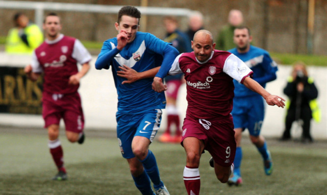 Lichties goal hero Paul McManus and Graham Webster of Montrose in a chase for the ball.