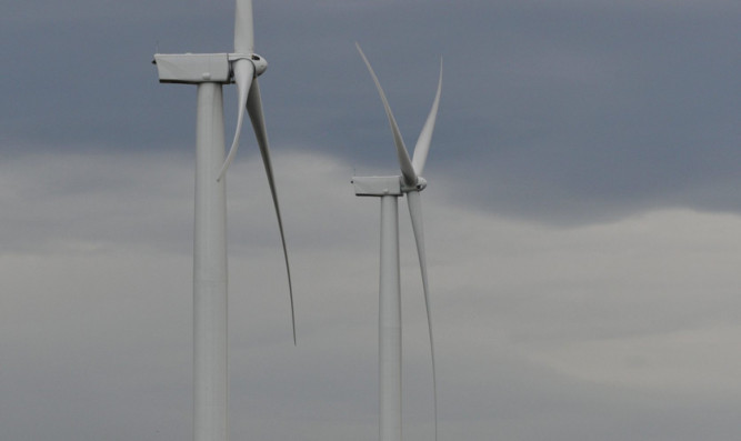 Kim Cessford - 06.11.12 - FOR FILE - pictured are two of the turbines in the wind farm next to Mossmorran, Fife showing an articulated lorry at it's base for scale