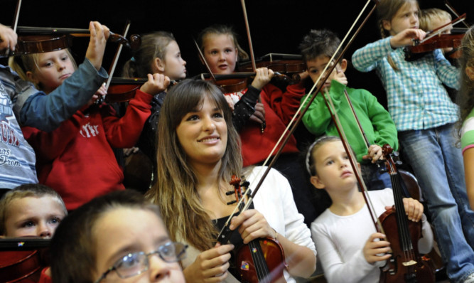 Nicola Benedetti giving music masterclasses to a children's orchestra set up in Stirling by the El Sistema project.