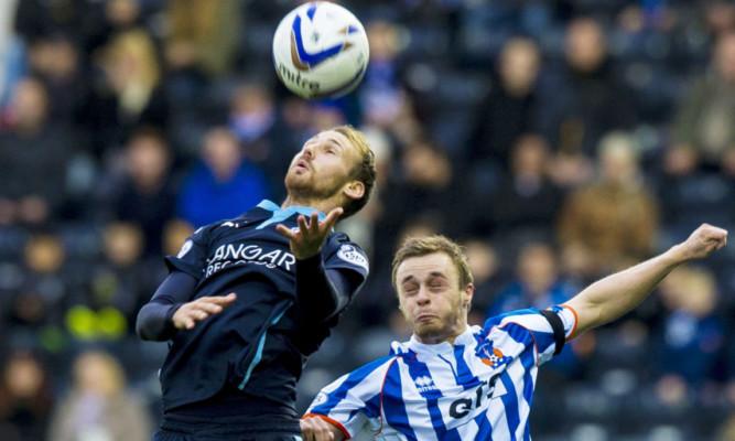 Dundee's Martin Boyle challenges Kilmarnock's Chris Chantler for the ball.