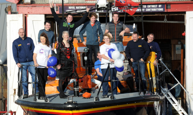 Front, from left: Dook organisers Rhona Harrison, Helen Angus and Alana Loudon with some of the RNLI volunteers at Arbroath.