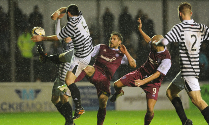 Arbroath apply some pressure in the goalmouth.