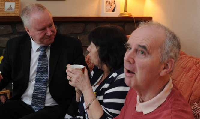 Health Secretary Alex Neil visiting Amanda and the late Frank Kopel earlier this year to discuss support for sufferers of Alzheimers disease under 65.