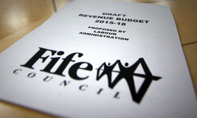 Kris Miller, Courier, 18/11/14. Picture today at Fife House, Glenrothes where the local council Executive Committee held a draft budget meeting for 2015/16 led by Council leader, Councillor David Ross. Pic shows a copy of the paper.