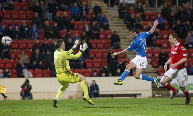 Brian Graham smashes an effort off the woodwork.