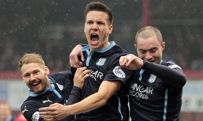 Konrad (centre) celebrates opening the scoring against Aberdeen.