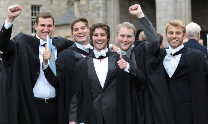 From left: Eric Andrews, Max Goodman, James Owens, Henry Hayes and Cole Sedgwick celebrate in St Salvators Quadrangle after their graduation ceremony last year.