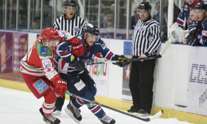 Dundee Stars Igor Gongalsky and Cardiff Devils Luke Piggott tussle during the clash in Dundee  another defeat for the Tayside team.
