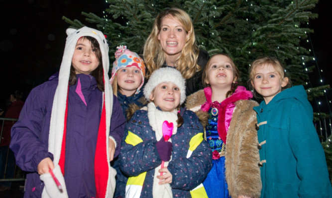 Eilidh Child with local youngsters.