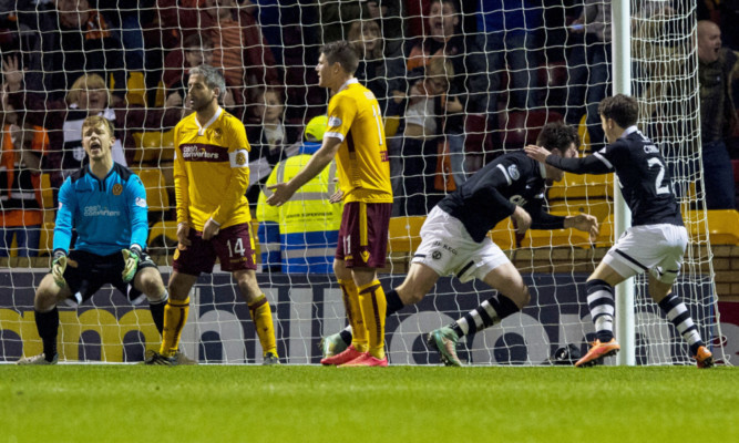 John Souttar (2nd right) charges off to celebrate his equaliser.