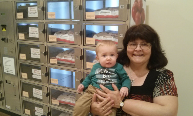 Jill Darling with her grandson Oliver at the vending machine.