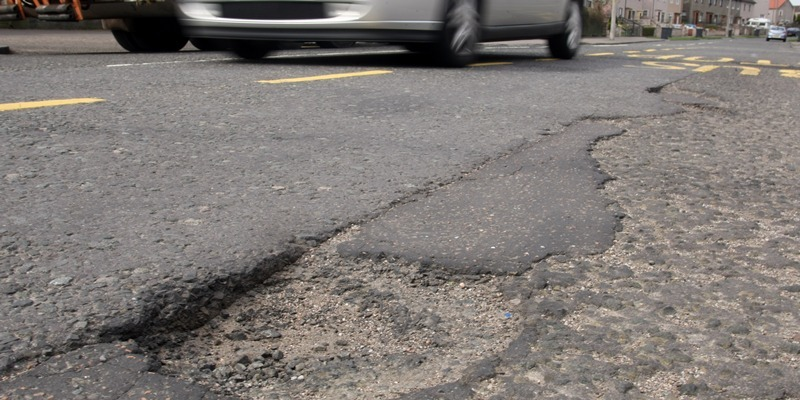 Potholes, a pothole in Laird Street, Dundee.